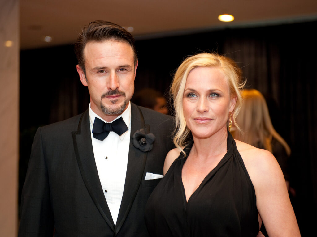 Patricia and David Arquette pose together in formal wear