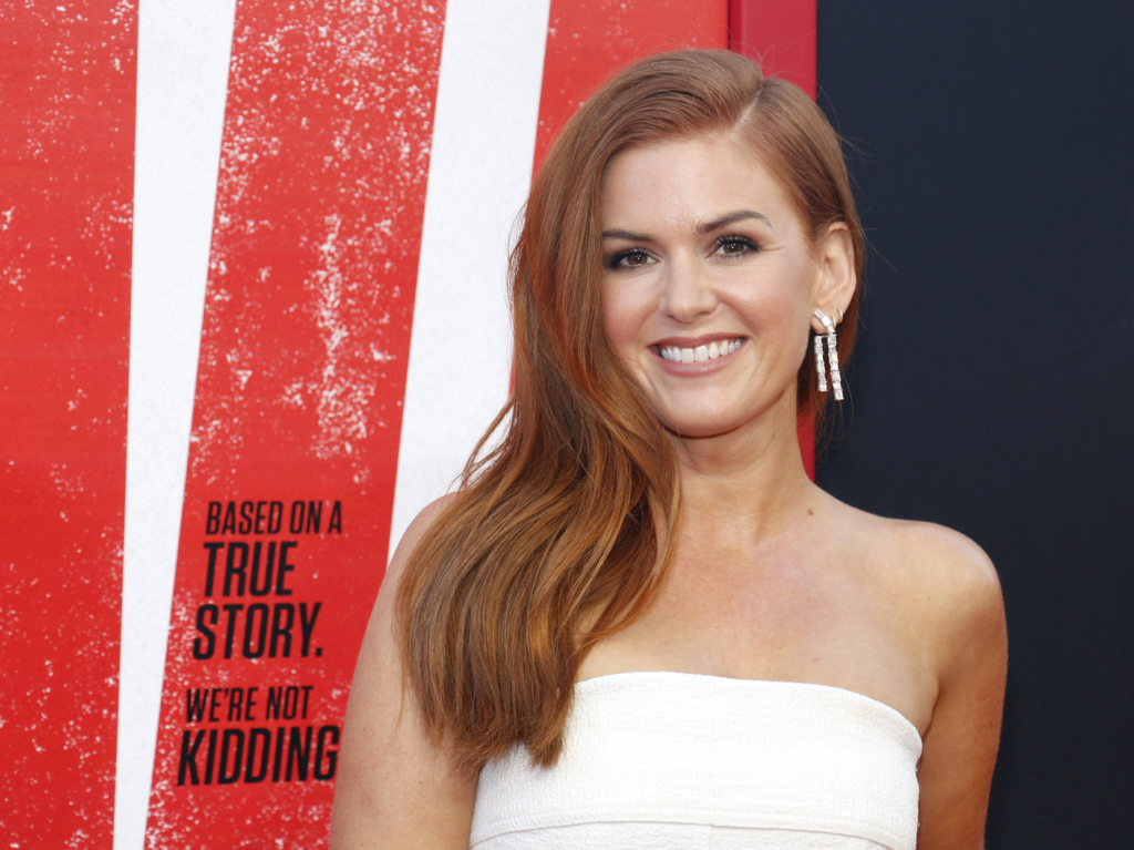 Isla Fisher wears a strapless white dress at a movie premiere