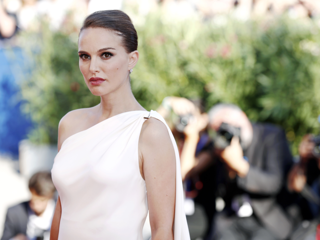 Natalie Portman sends a steamy stare at the camera in a white one-shouldered dress