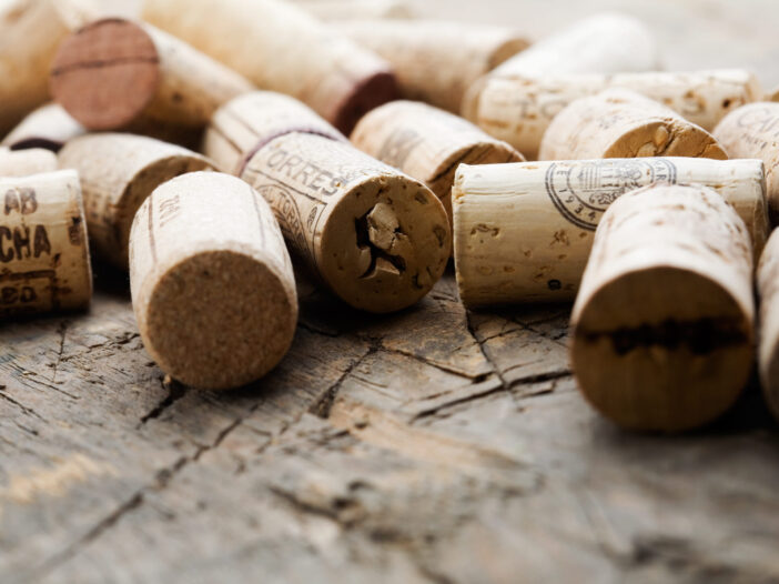 Close up of wine corks on a wood table.