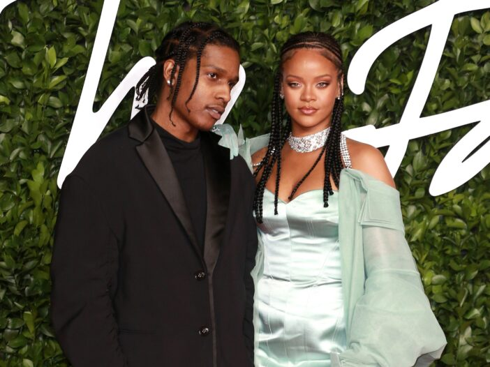 A$AP Rocky wears all black as he stands with Rihanna, in mint green on the red carpet