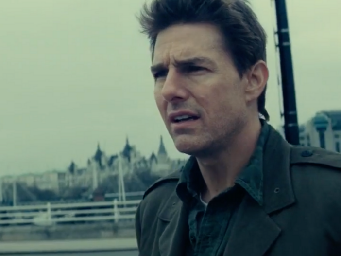 A still from the film Edge Of Tomorrow starring Tom Cruise, who stands atop a bridge in London weari