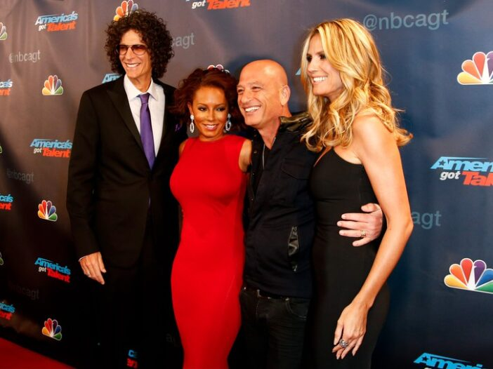 AGT judges Howard Stern, Mel B, Howie Mandel, and Heidi Klum on the red carpet