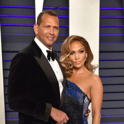 Alex Rodrigeuz on the left in a tuxedo, Jennifer Lopez on the right in a sparkly dress.