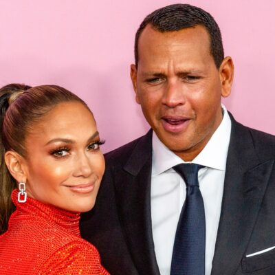 Alex Rodriguez looking confused as he stands next to Jennifer Lopez (left)