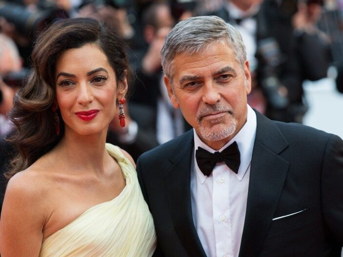 Amal Clooney on the left, George Clooney on the right.