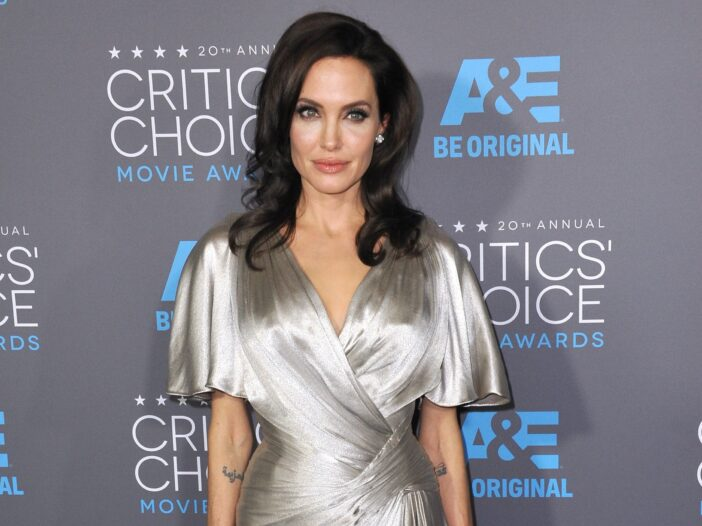 Angelina Jolie in a long, silver dress.