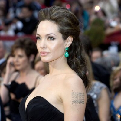 Angelina Jolie wearing a strapless black dress at the Academy Awards