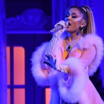 Ariana Grande in a pink and feathery outfit performing at the Grammys