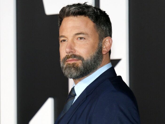 Ben Affleck in a suit, looking to the left.