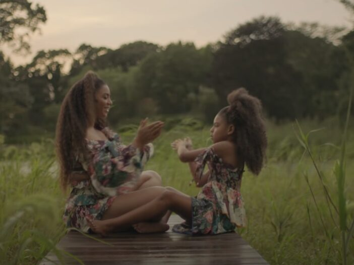 """Beyonce and her daughter Blue Ivy playing at the edge of a dock in the music video """"Brown Skin Girl"""""""