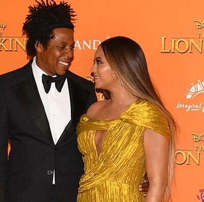 Jay-Z and Beyonce looking at each other on the red carpet at the premiere of The Lion King