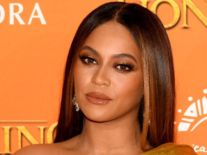 Beyonce looking at the camera on the red carpet at the Lion King premiere