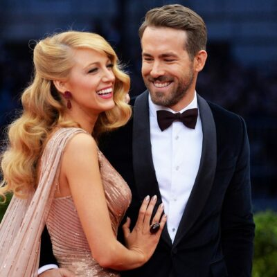Blake Lively and Ryan Reynolds walking the red carpet wearing fine evening wear.