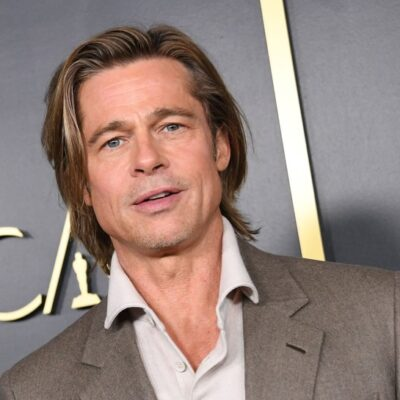 Brad Pitt in a tan suit at an Oscars event in 2020.