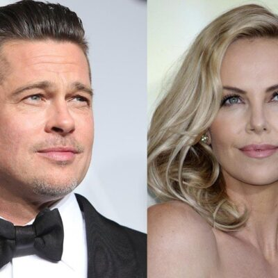 Brad Pitt on the red carpet in a tux. Charlize Theron on the red carpet wearing a strapless dress