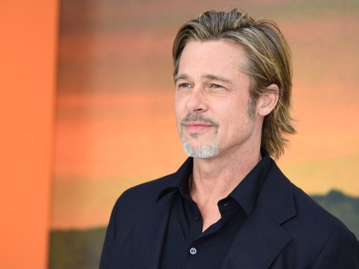 Brad Pitt wearing a black suit jacket at the London premiere for Once Upon A Time In Hollywood
