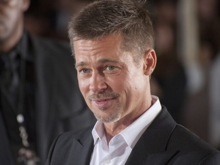 Brad Pitt with a wry smile on his face.