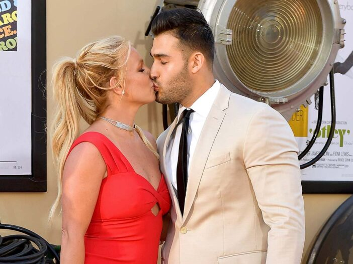 Britney Spears and Sam Asghari kissing at a red carpet event