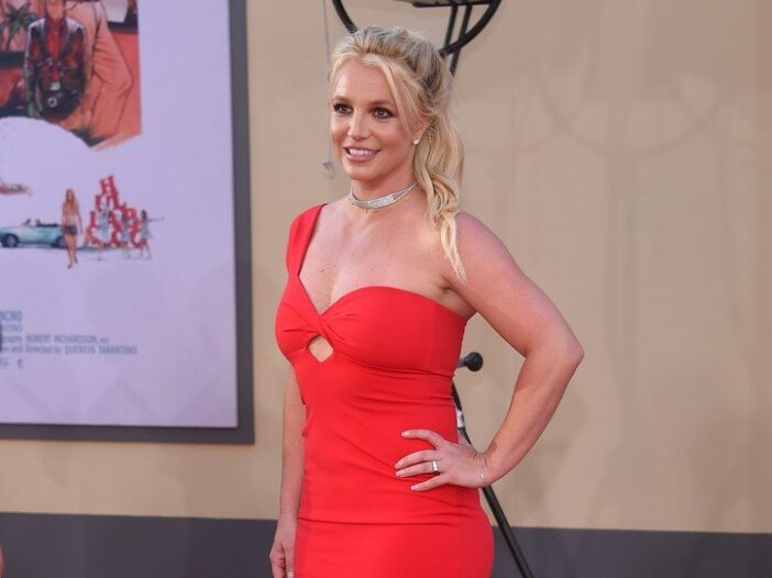 Britney Spears in a red dress at a movie premiere.