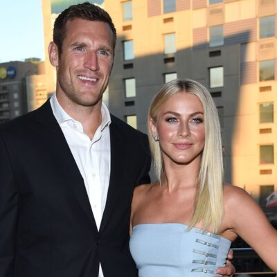 Brooks Laich, in a black suit, stands with Julianne Hough, in a blue dress to a gala in 2016