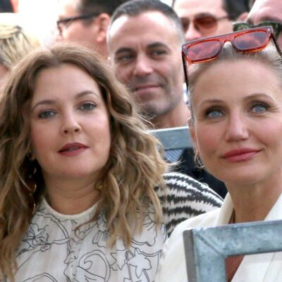 Cameron Diaz and Drew Barrymore sitting together outside
