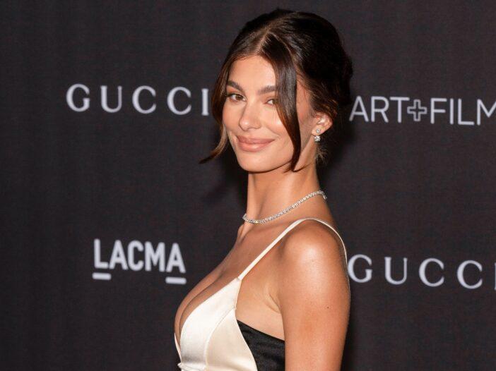 Camila Morrone arrives at the LACMA Art + Film Gala wearing a cream colored dress