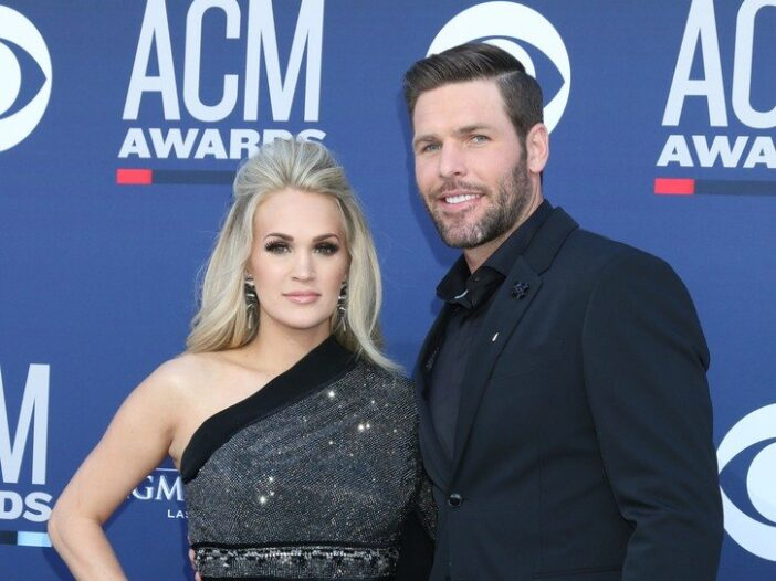 Carrie Underwood (right) with Mike Fisher (left) at the ACMs in 2019.