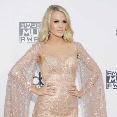 Carrie Underwood wearing a glittering beige dress to the American Music Awards