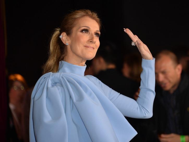 Celine Dion waving in a blue dress