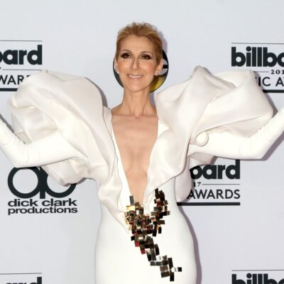 Celine Dion wears a white dress with a gold geometric detail to the Billboard Music Awards