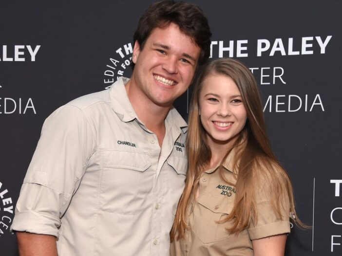 Chandler Powell on the left, Bindi Irwin on the right, both wearing their khaki uniforms.