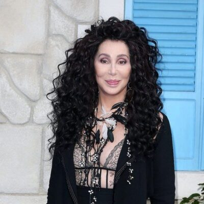 Cher in a black outfit outside