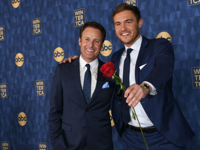 Chris Harrison and Peter Weber wearing dark navy suits on the red carpet
