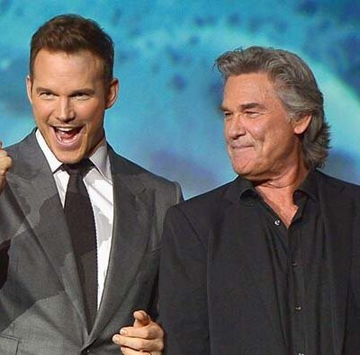 Chris Pratt pumping his fist next to a smiling Kurt Russell at a Guardians Of The Galaxy press event