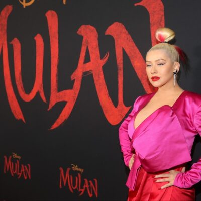 Christina Aguilera at the premiere of Mulan in March, in a pink dress.