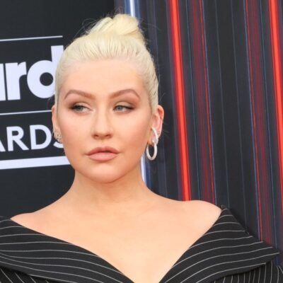 Christina Aguilera giving a little side-eye at a red carpet event.