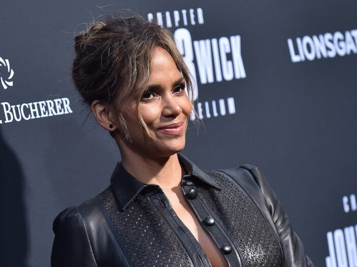 close up of Halle Berry in a black leather dress at a red carpet event