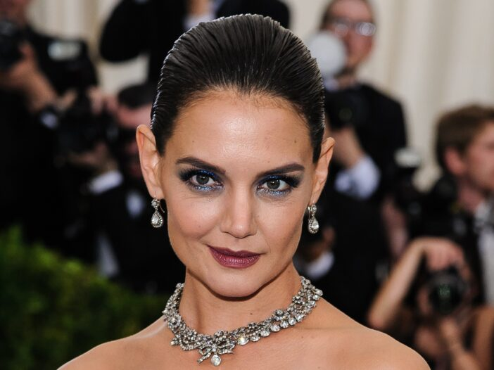 Close up of Katie Holmes with dramatic, dark makeup on