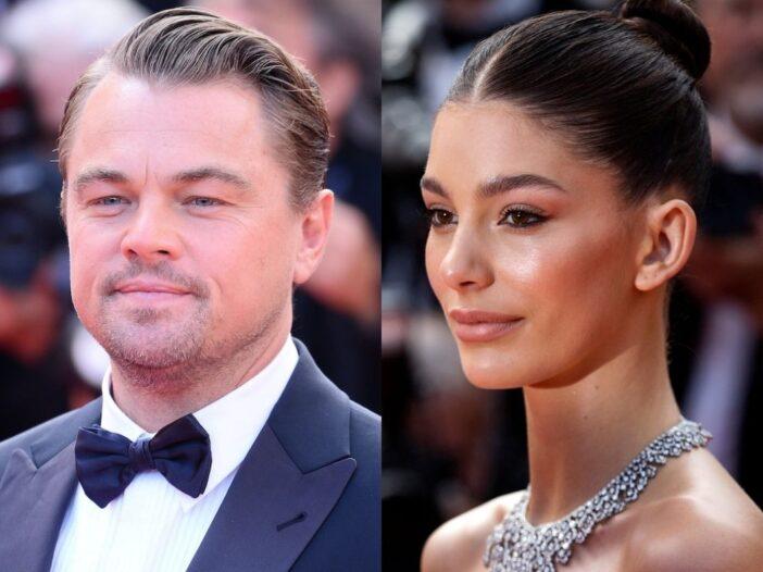 close up of Leonardo DiCaprio smiling in a tuxedo outdoors