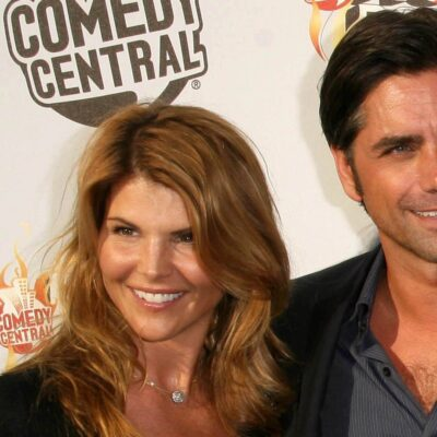 Close up of Lori Loughlin on the left, standing with John Stamos on the right.