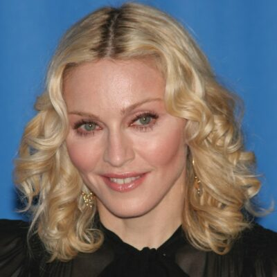 Close-up of Madonna with blonde hair in a black dress.