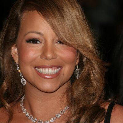 Close up of Mariah Carey wearing a diamond necklace.