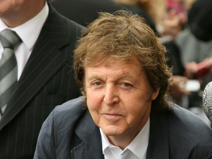 Close up of Paul McCartney in a suit and no tie