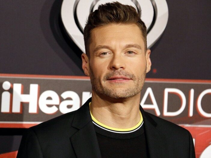 close up of Ryan Seacrest in a black suit jacket and black sweater