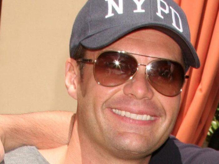 Close up of Ryan Seacrest wearing sunglasses.