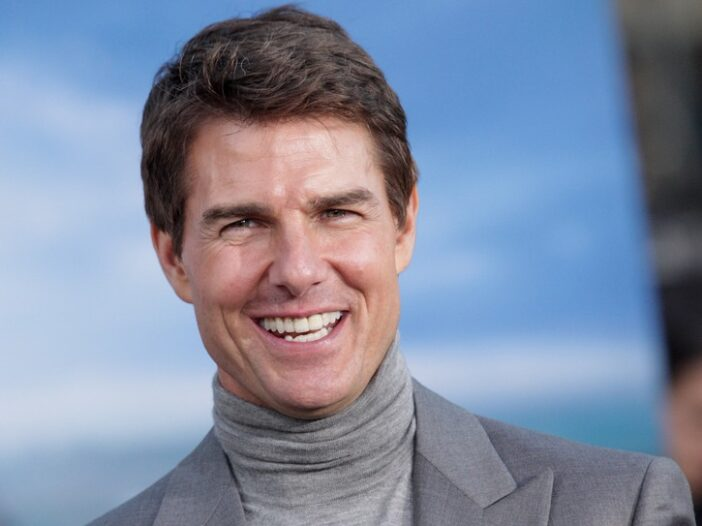 Close up of Tom Cruise in a gray turtleneck