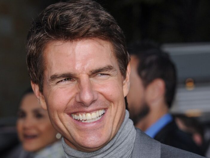 Close up of Tom Cruise smiling.