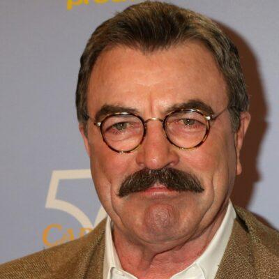 Close up of Tom Selleck wear eyeglasses.