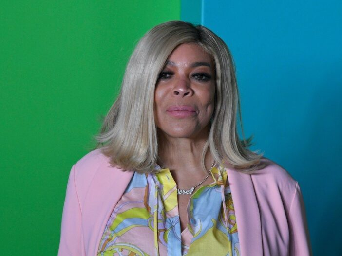 Close up of Wendy Williams in a pink cardigan and blouse